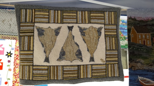 A rug with three dried cod